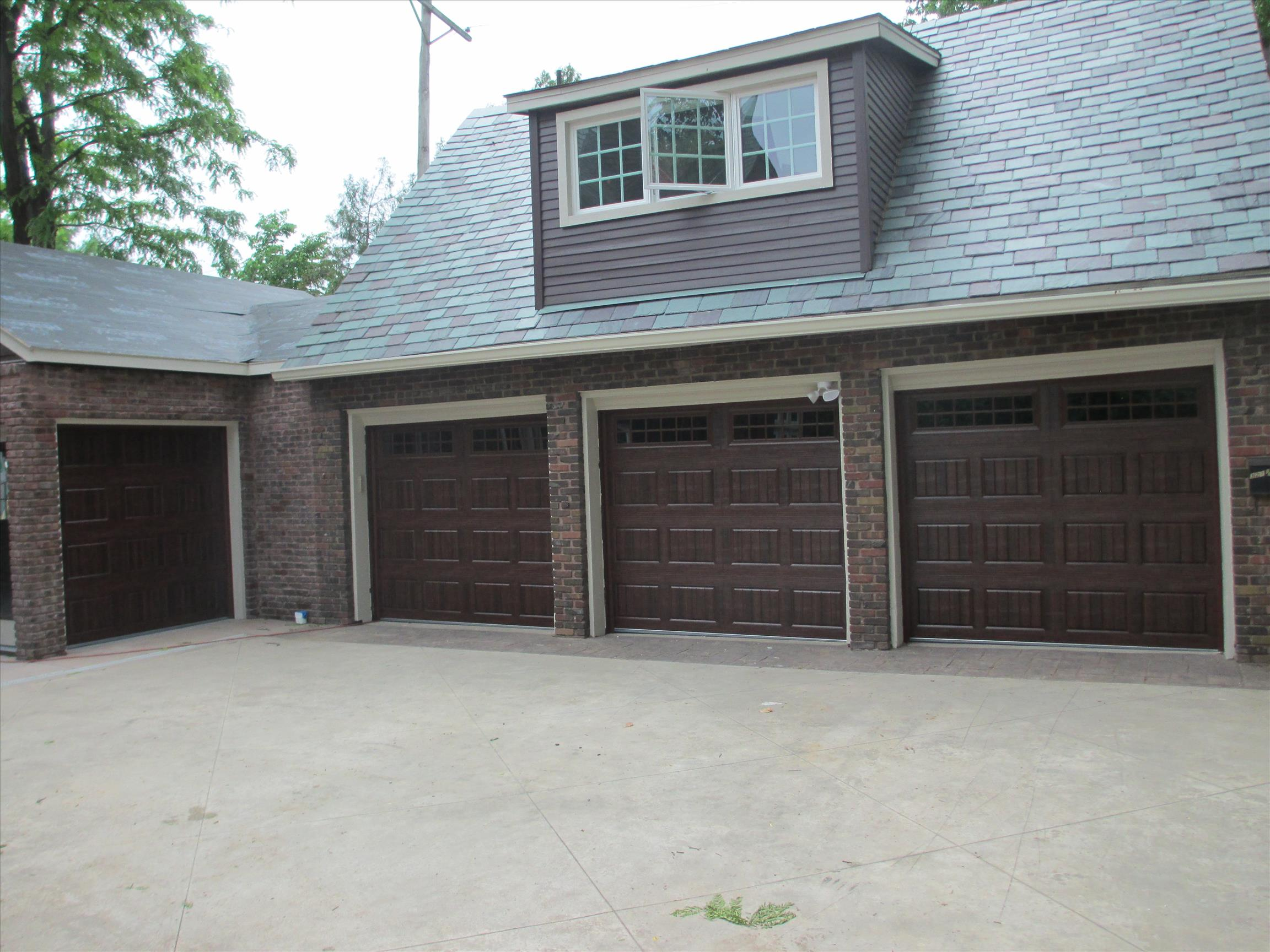 dark red garage doors with windows